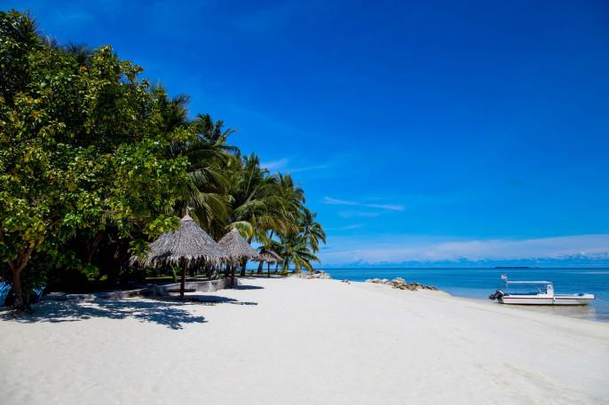 White sand beach on Mabul island, Sipadan, Borneo Malaysia iStock_000014748987_Large-2