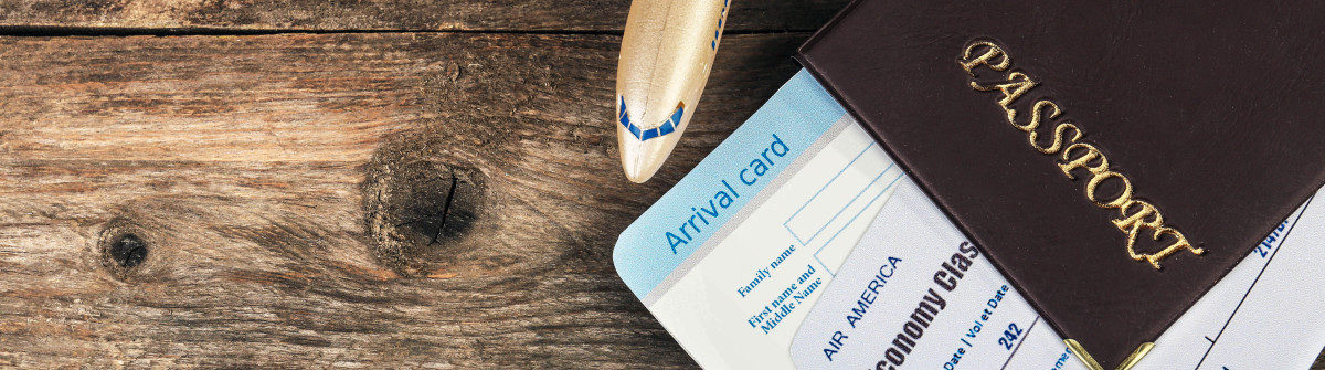 airline-tickets-and-documents-on-wooden-background-shutterstock_269588303-2-1200×335