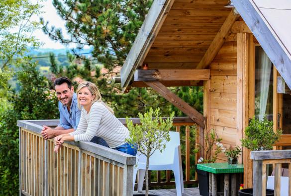 family-enjoying-vacation-in-log-cabin-shutterstock_219081379-2-585x395