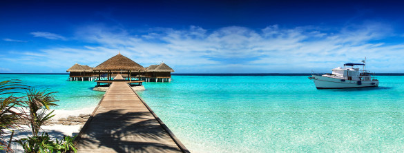 rest-in-the-maldives-and-a-yacht-cruise-on-the-ocean-istock_000072801683_large-2-585x222
