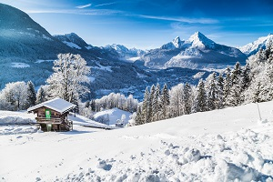 Winter wonderland with mountain chalet in the Alps