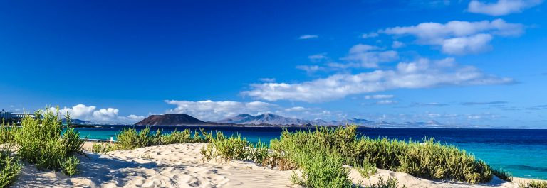 lobos-and-lanzarote-seen-from-corralejo-beach-fuerteventura-istock_000048832316_large-2