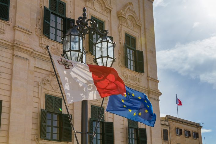Maltese-and-European-Union-EU-Flag-flying-in-front-of-beautiful-Auberge-de-Castille-the-office-of-the-prime-minister-of-Malta_shutterstock_626934605