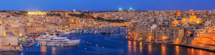 View-to-Grand-Harbor-from-Upper-Barrakka-Gardens-at-sunset-Valetta-Malta_shutterstock_676083529