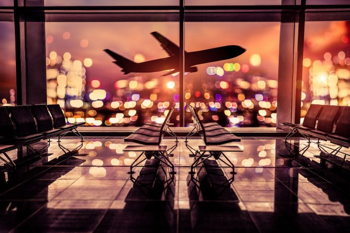 Airport Lounge and airplane take off in the city