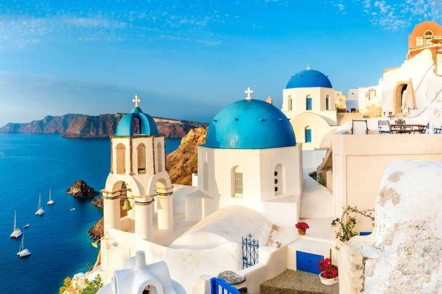 Local church with blue cupola in Oia village, Santorini island, Greece