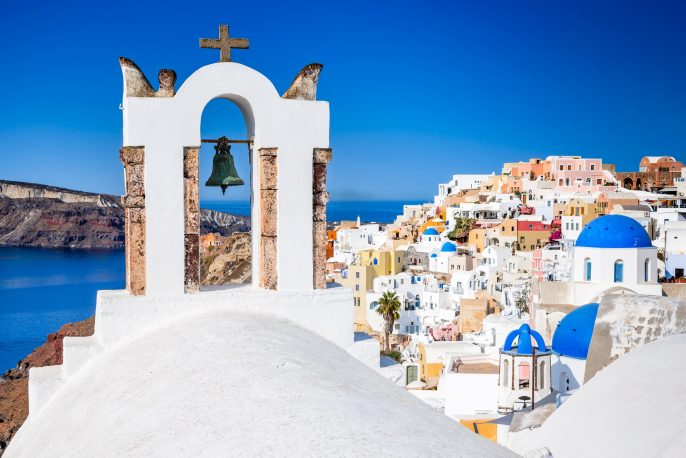 Oia-Santorini-Greece.-Famous-attraction-of-white-village-with-cobbled-streets-Greek-Cyclades-Islands-Aegean-Sea-shutterstock_722921995