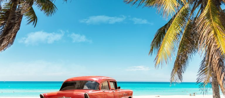 old red american car on Varadero Beach in Cuba