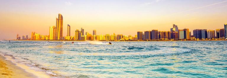 Beach-with-backdrop-of-Abu-Dhabi-skyline-at-sunset-VAE-iStock_000022783355_Large-2