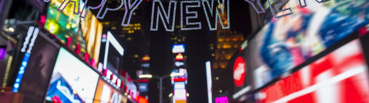 Glittery-Happy-New-Year-message-strung-across-the-flashing-lights-of-Times-Square-New-York-City-shutterstock_543169873