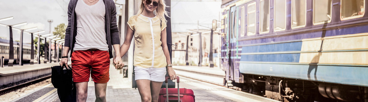 young-couple-waiting-for-a-train-on-platform-istock_000031131506_large-2-1200x335