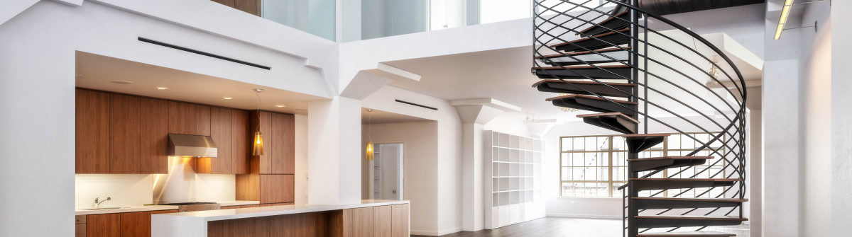 empty-room-of-residence-with-a-spiral-staircase-shutterstock_154341227-2-1200×335
