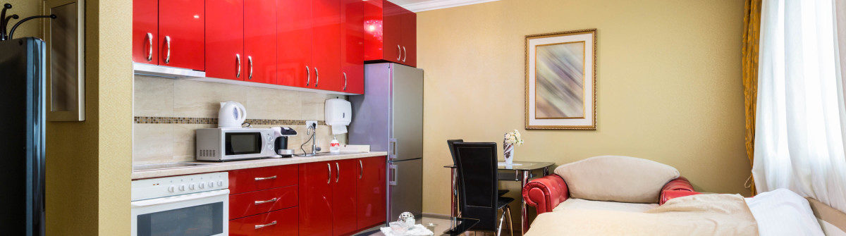 small-apartment-with-bedroom-and-kitchen-istock_78124567_xlarge-2-1200×335