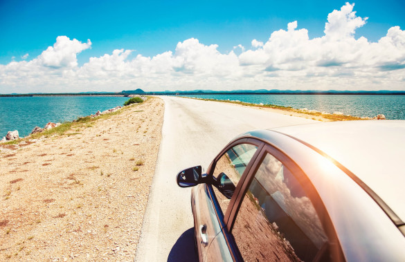 car-driving-across-ocean-by-the-road-shutterstock_141621238-2-585x379