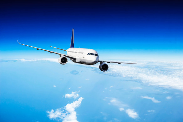 commercial-jet-plane-flying-above-clouds-istock_94634997_xlarge-2-585x390