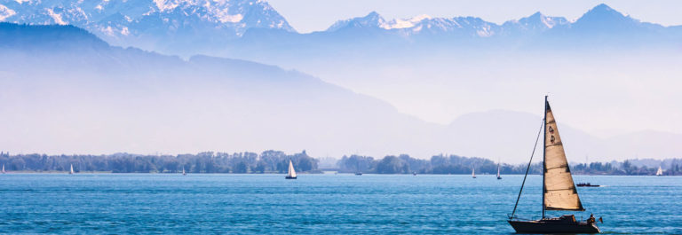 boats-on-the-lake-of-constance-with-the-alps-in-the-back-ground-shutterstock_211194940-2